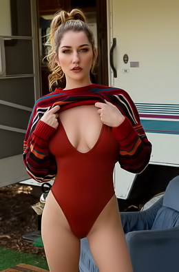 Skye Blue looks stunning while removing her red tight bodysuit