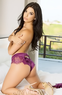 Cute doll Gina Valentina seduces in the bedroom